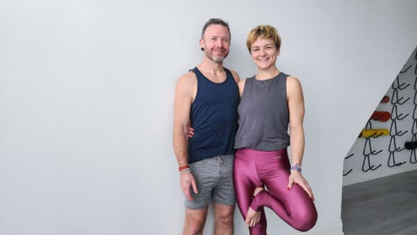 David and Jelena Standing In The Yoga Studio